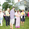 Members of the D'Amico family, including Sara, left, and Marie, applaud Dr Michael Taweh's remarks while listening to his speech Saturday at George and Shane Miller's house at 50 Main Street Saturday, September 7, for the annual Mozart, Merlot & Mums fundraiser. (Bobowick photo)