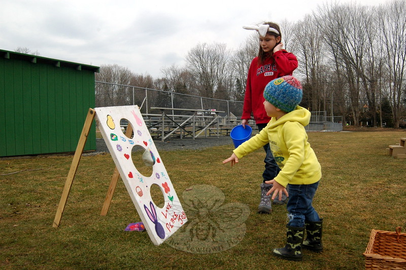 Luciano Montanez scored a point by tossing a bean bag at the Bunny Watch on Friday.