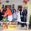 "Newtown First Selectman Pat Llodra, far left, helps Burrito Shack owner ""Johnny Baby"" Wilson with the big scissors as he, his family, and staff celebrated the official ribbon cutting at their new restaurant at 314 South Main Street. The Burrito Shack officially opened March 9. (Voket photo)"