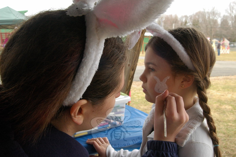 Mariella Montanez had a bunny painted on her face by Catherine Menousek during the Bunny Watch on Friday. (Hallabeck photo)