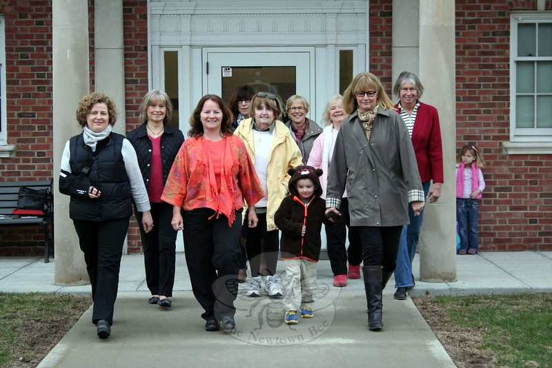 Following the April 7 meeting of Newtown VNA, members joined Director of Health Donna Culbert, third from left, for a quick step outdoors in honor of Start Walking Month. Ms Culbert is hoping residents of all ages will consider adding walking to their regular routine. Kellen Vollinger, grandson of VNA member Anna Wiedemann, was happy to join the group. He is holding the hand of VNA President Mary Tietjen. (Hicks photo)