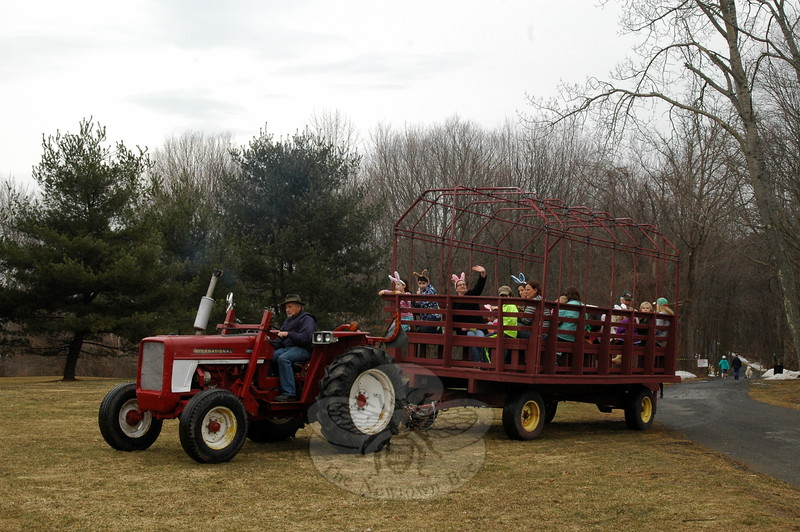 George Birch drove one of the antique tractor-pulled wagon rides on Friday, April 3, the first day of this year's Bunny Watch. (Hallabeck photo)