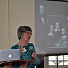 Author and gardening expert Marta McDowell narrates a slide show of Emily Dickinson's family, discussing the poet's use of botanical terms in many of her famous poems. Ms McDowell, the author of books on Ms Dickinson and children's illustrator/author Beatrix Potter, also talked about Ms Potter's love of nature found in her watercolors and stories. (Crevier photo)