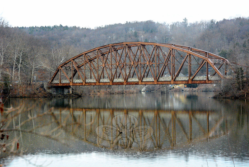 Silver Bridge as viewed from the town park off Bridge End Farm Lane. The state is starting work on a $4.474 million project to rehabilitate the aging truss-style bridge that links Glen Road in Sandy Hook to River Road in Southbury. The bridge is about 300 feet long. Workers soon will be placing signs in the area alerting motorists of the bridge project. (Gorosko photo)