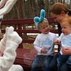 Brothers Jack, left, and Charlie and mom Alison Langenus met the Easter Bunny on Friday, April 3, during an antique tractor-pulled wagon ride at this year's Bunny Watch. (Hallabeck photo)