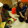 Middle Gate Elementary School fourth grader Emma Smith, right, read on Friday, April 6, while kindergartener Aarav Shetty, center, and fourth grader Eli Stan looked on. (Hallabeck photo)
