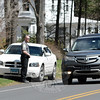 "Newtown Police Officer Jason Flynn, a member of the police department's traffic unit, watches passing traffic on Wednesday, April 15, on westbound Sugar Street (Route 302), checking for motorists who are violating the state's distracted driving laws. From April 13 to April 27, town police are conducting an enforcement crackdown against distracted drivers, especially those who are using a handheld cellphone while driving or texting while driving. The national enforcement project is known as, ""U Drive, U Text, U Pay.""   (Gorosko photo)"