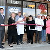 Café Xpresso at 150 South Main Street celebrated its official opening with a brief ribbon cutting event April 6. Among those attending, from left, were Newtown Economic Development Commissioner Matt Mahalcek, First Selectman Pat Llodra, Café Xpresso owners Bob and Marie Schlump, Chef Bernie Doyon, EDC Commission Chair Jean Leonard, and Grants Coordinator Betsy Paynter. (Voket photo)