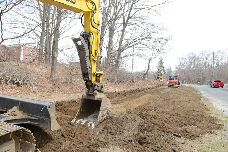 LRM Construction on Monday, April 13, began building what will be nearly one mile of additional trail space at Fairfield Hills. The trail will be a paved surface, which begins near the Cochran House parking lot along Mile Hill South. (Bobowick photo)