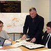At an April 9 Water & Sewer Authority (WSA) public hearing, developer/builder Michael Burton, standing, points to some details on his sewering application for a proposed 74-unit housing complex on Washington Avenue in Sandy Hook Center, known as The River Walk At Sandy Hook Village. Seated are WSA Chairman Marianne Brown, left, and engineer Kurt Mailman of the town's consulting engineering firm Fuss & O'Neill, Inc. (Gorosko photo)