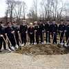 First Selectman Pat Llodra, center, joined 12 uniformed members of the Newtown Hook & Ladder Volunteer Fire Company at groundbreaking ceremonies for a new firehouse held on Wednesday, April 22, at the construction site at 12 Church Hill Road. The fire company hopes to move into the 16,000-square-foot facility in the spring of next year. (Gorosko photo)