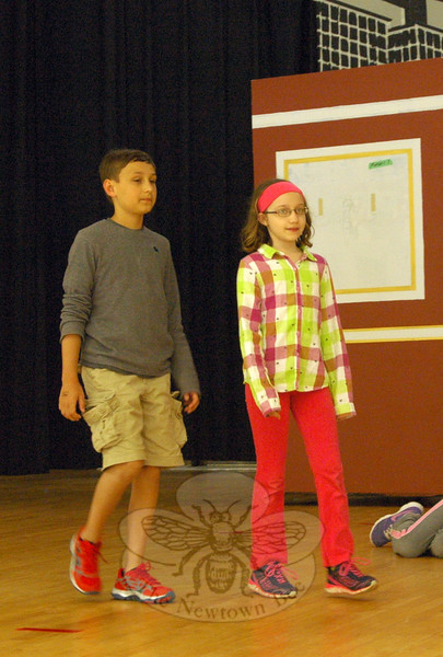 C.J. Hoekenga, left, and Quinlyn Kessler, right, rehearsed their parts of Warbucks and Annie during a rehearsal on Tuesday, April 21, for Reed Intermediate School's upcoming musical production of Annie Jr. (Hallabeck photo)