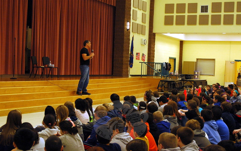 Tim Green spoke before a cafetorium filled with Reed Intermediate School students during one of his presentations in Newtown on April 3. (Hallabeck photo)