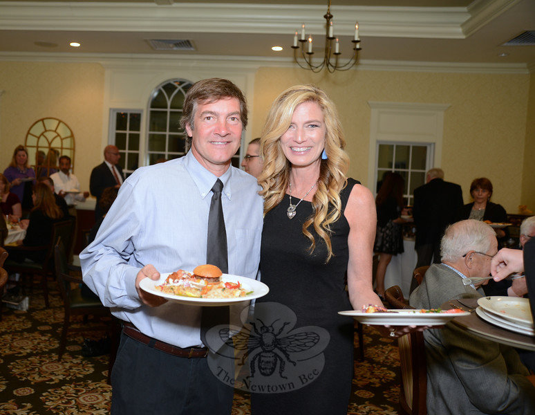 "William and Amy Mangold enjoy a buffet dinner at the Rock Ridge Country Club during the ""Modeling For Makers"" fundraiser. (Bobowick photo)"