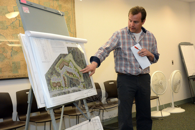 Landscape architect Robert Sherwood, representing local developer/builder Michael Burton, describes a generalized landscaping plan for The River Walk at Sandy Hook Village, a 74-unit housing complex proposed for the west side of Washington Avenue in Sandy Hook Center. Mr Sherwood spoke at an April 22 Inland Wetlands Commission meeting. (Gorosko photo)