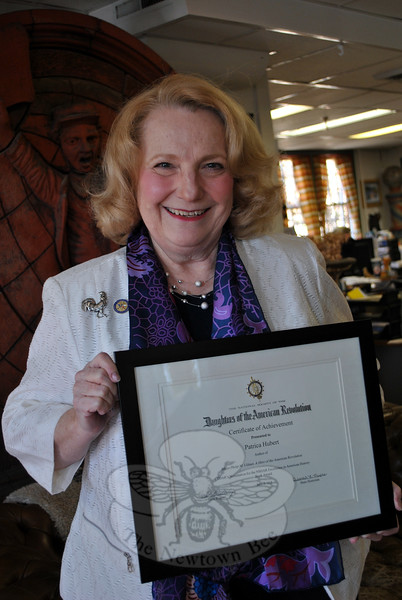 Pat Hubert holds the Certificate of Achievement for Excellence in American History Book Award, received from the State Daughters of the American Revolution, for her book Major Philip M. Ulmer: A Hero of the American Revolution. The book has also been nominated for the award at the national level. (Crevier photo)
