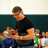 Tim Green read from his book Unstoppable, one of his many books, before Newtown Middle School students in the school's gymnasium on Thursday, April 3. (Hallabeck photo)