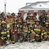 The 22 firefighters who participated in the 2015 Sandy Hook 5K assembled on the northwest lawn of Newtown Municipal Center, just yards away from the Start-Finish line, after completing the road race on March 28. Members of East Litchfield Kent, Pleasant Valley, and Washington fire companies were joined by six members of Sandy Hook Volunteer Fire & Rescue for the event. (Hicks photo)