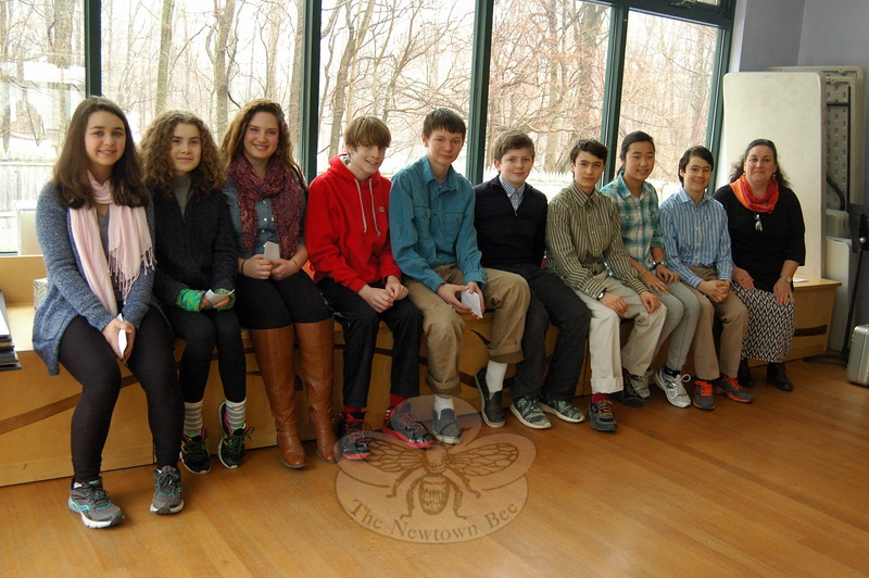 Housatonic Valley Waldorf School eighth grade students sat together before rehearsing their eighth grade projects on Thursday, March 26. From left are Bayley Storrier, Maeve Rooney, Lena DeFeo, Dempsey Reese, John Disprow, Michael Whipf, Jeremy Larkin, Sanni Cohn, Dillon Larkin, and eighth grade teacher Leslie Lew. (Hallabeck photo)