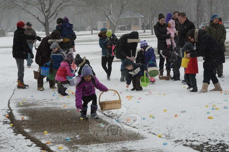Tots bent down to retrieve some of the several thousand Easter eggs that had been placed at the play-ground at Dickinson Park on Saturday, March 28 during the town's annual Spring Egg Hunt. (Gorosko photo)