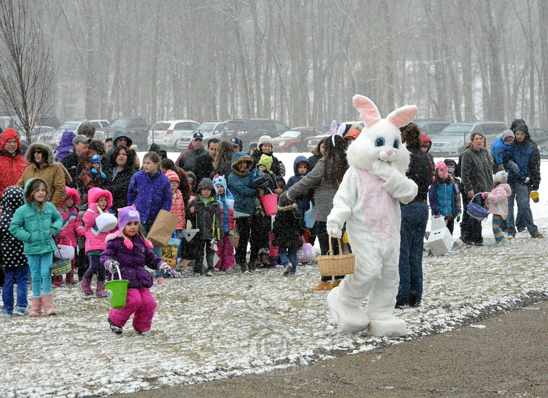 A happy Easter Bunny led a group of about 200 children and parents across a snowy field at Dickin-son Park on Saturday, March 28, to the new playground, known as FunSpace II, where about 4,000 Easter eggs were scattered on the ground at the town's annual Spring Egg Hunt. There was nothing springlike about the day, however, as snow fell steadily throughout the event. (Gorosko photo)