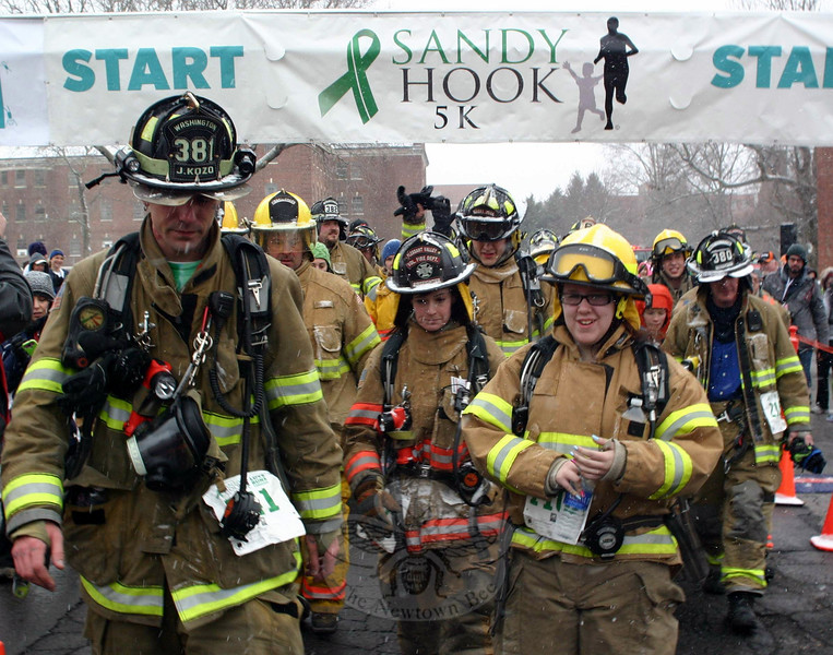 Washington Depot Volunteer Fire Department Firefighter Jeff Kozo, on the left, was the driving force behind the participation of nearly two dozen firefighters in last weekend's Sandy Hook 5K. Mr Kozo had promised that all firefighters would finish the challenge together. (Hicks photo)