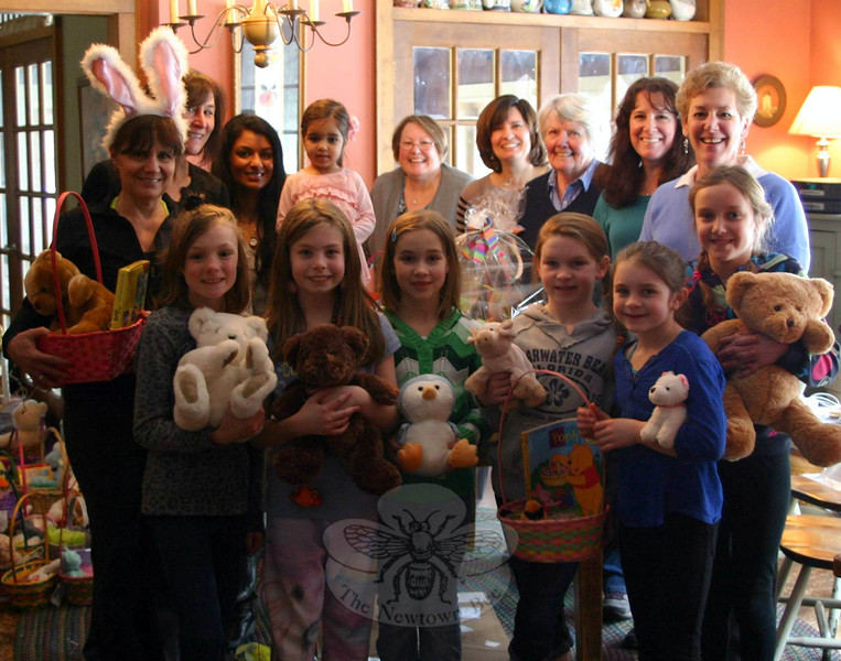 Mandy Monaco and Sue Roman, the two women on the left in this photo, co-chaired the 17th Annual WIN Easter Basket Project. For years, Women Involved in Newtown have created Easter baskets and decorated candy bags to distribute to area children and young adults in need. This year the group was helped by The Rainbow Peace Girls, a group of Middle Gate Elementary School fourth graders who did their own collection of stuffed animals and plastic grass for the WIN project. The girls dropped off the final collection of items donated by their classmates on March 26, the same day members of WIN spent a few hours at the Monaco home assembling baskets. This year WIN provided 56 baskets and 15 candy bags to Newtown Social Services, 30 baskets to AIDS Interfaith Ministry in Danbury, 12 baskets and 35 candy bags to Healing Hearts Center For Grieving & Loss in Danbury, and 20 baskets to St Rose of Lima Church in Newtown. (Hicks photo)