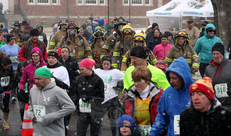 The firefighters participating in the 2015 Sandy Hook 5K were right in the middle of runners and walkers last weekend when the starting horn went off. Bundled in their turnout gear, they were warmer than others who opted for shorts and lighter clothing on the snowy morning. (Hicks photo)