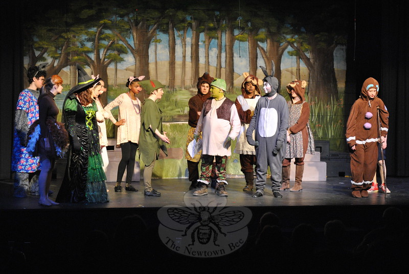 Shrek, portrayed by Jackson Mittleman, spoke with Peter Pan, played by Mackenzie Browne, in the middle school's production of Shrek The Musical Jr. (Hallabeck photo)