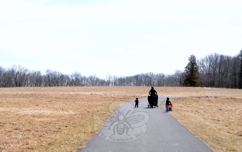 Maureen Pendergast and her children James, Alison, and Luke stroll uphill on a Fairfield Hills trail. Ms Pendergast this week enjoyed the almost 50-degree weather early in the day Tuesday. (Bobowick photo)