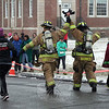 "Firefighters Rob Sibley and Pete Barresi raised their hands as they approached the finish line. Mr Sibley called the event ""exhilarating,"" while Mr Barresi said he felt ""euphoric"" when he finished the 5K course. (Hicks photo)"