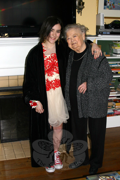 """Jean Fadus of Newtown recently discovered a treasure in her attic: the black velvet full-length coat she wore to her junior prom in 1946. In pristine condition, the coat was offered to Jean's granddaughter Olivia, also of Newtown, who added it to her outfit for her own junior prom last weekend. On March 27, Olivia and her boyfriend Luke Gaynor headed off to The Amber Room in Danbury to join their fellow Newtown High School classmates for an evening out. Jean was thrilled to find the coat, saying there """"was not one little mark on it, and it fits her beautifully."""" Olivia combined the vintage coat with a cute cream-colored dress with red lace accents, and red Converse sneakers. Luke went a more traditional route, wearing in a black tux when he arrived at the home of Olivia and her parents to pick up his date for the prom. (Hicks photo)"""