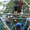 Several children climb amid a network of nylon ropes stretched between metallic members in a geometric structure at the new playground at Dickinson Park on July 26. Although the playground was formally dedicated on Saturday, it was open to the public for only a few hours. Parks & Rec crews have been completing safety surfacing and borders this week, with the hope to officially open the playground for good by early next week. (Gorosko photo)