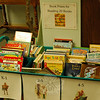 Children who read 20 books can choose a book to take home from a cart located in the Children's Department at the library. They also have their photo taken and added to a display in the department. (Gaston photo)