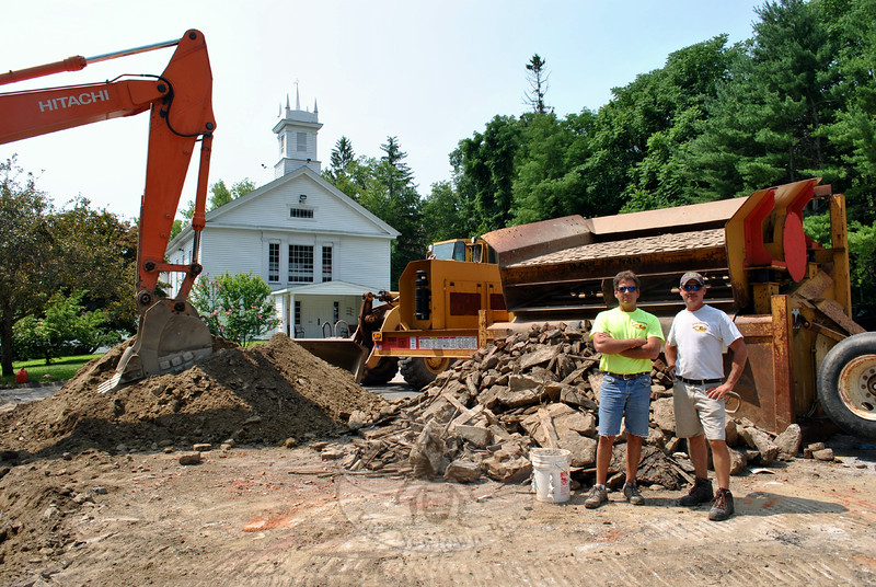 David and Darin Renihan of Site Services in Roxbury stand next to a pile of concrete dug out of the parking lot at Newtown United Methodist Church. The debris is the last of the historic Fredericka House that once stood at 92 Church Hill Road. (Crevier photo)