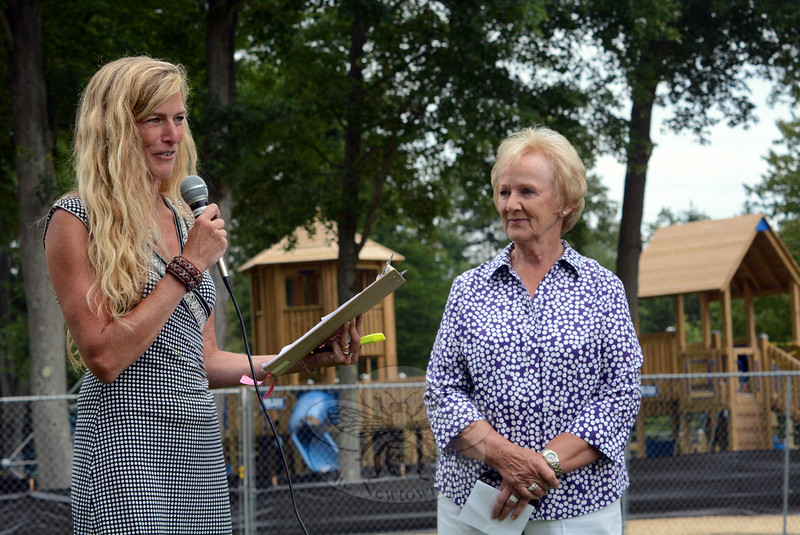 Parks and Recreation Director Amy Mangold, left, speaks as First Selectman Pat Llodra listens during dedication ceremonies held on Saturday, July 26, for FunSpace II, the town's new playground at Dickinson Park on Elm Drive.  (Gorosko photo)
