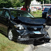 This compact car received heavy front-end damage in a two-vehicle accident that occurred on South Main Street near its southern intersection with Elm Drive at about 11:25 am on August 6. Police said motorist Megan Chervansky, 29, of Sherman was driving a 2004 Acura TSX sedan southward on South Main Street and then slowed in preparing to make a left turn into a driveway at 79 South Main Street, when the Acura was struck from behind by southbound motorist Blake McCoy, 26, of Bridgeport, who was driving a 2010 Toyota Corolla sedan. Both drivers reported pain as a result of the impact, police said. The Acura was carrying a 2½-year-old child as a passenger, according to police. The Newtown Volunteer Ambulance Corps and Newtown Hook & Ladder volunteer firefighters responded to the accident. Police said they issued McCoy an infraction for failure to drive a reasonable distance apart and for driving without a license. (Gorosko photo)