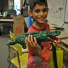 Eamonn Abdulrahman, 9, shows off the paper mache alligator he made at camp. (Crevier photo)