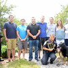From left is Newtown Police Officer Matthew Hayes with Newtown Kindness Dream Ride committee members Timothy Lalli, Tyler Hough, Chris Sferruzzo, Steve Bowers, Steve Grosso, Isabel Destival, and Steve Klucik. Officer Felicia Figol, the police department's K-9 handler, is kneeling with Newtown PD K-9 Saint Michael. (Bobowick photo)