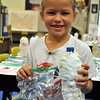 Six-year-old Norah Whitmore holds up the volcano and butterfly she made in Icky Sticky Chemistry, one of several classes SMART campers could take part in this summer. (Crevier photo)