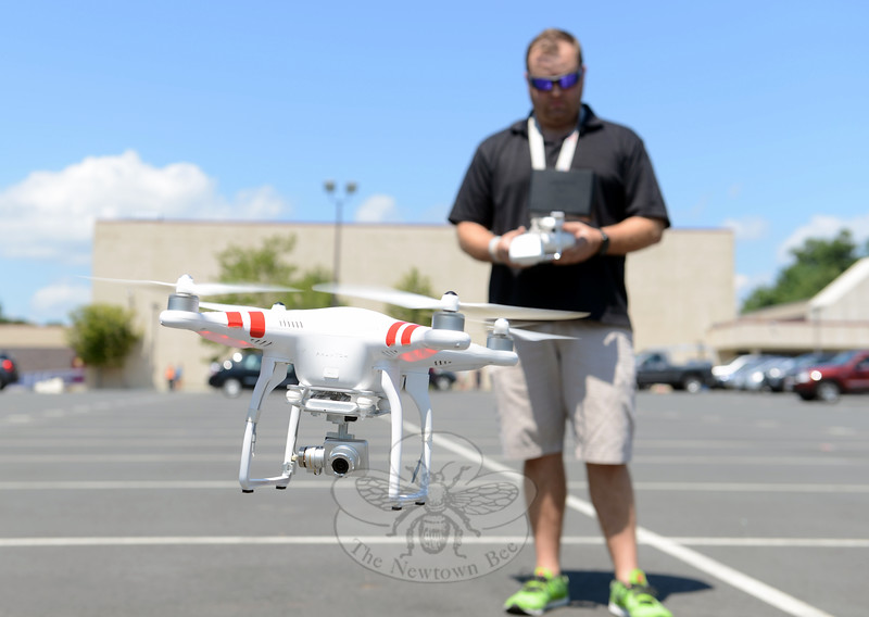 Aaron Johnson's most recent hobby — a combination of technology, photography, and remote controlled flight — has resulted in wide-angled aerial images of familiar places such as Ram Pasture, Hawley Pond, and last week, shots of Newtown High School's Blue & Gold Stadium. On August 4 he set up his DJI Phantom II Vision+ drone for a brief flight, which found the drone hovering first above the Berkshire Road parking lot, then soaring toward a pale blue sky above the football field. From there he dropped the drone to hover at the 50-yard line, then toward the goal posts. (Bobowick photo)