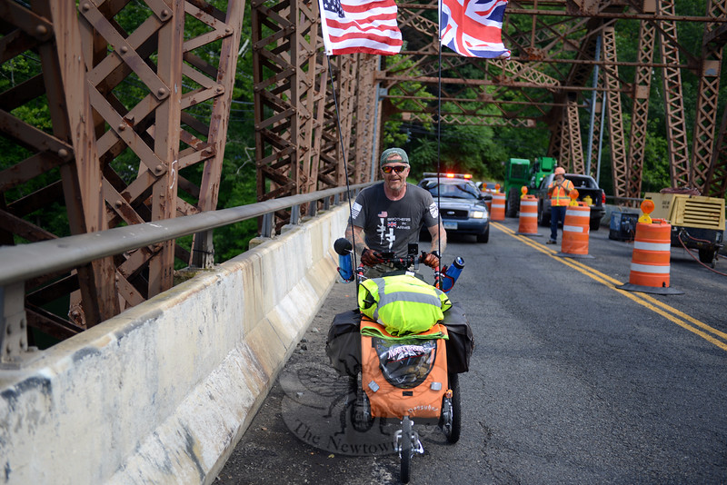 Coming across the Steel Bridge from Southbury into Newtown Wednesday afternoon is Neil Davis, a one-man effort to cross the country from Massachusetts to California to raise awareness and funds for veterans. (Bobowick photo)