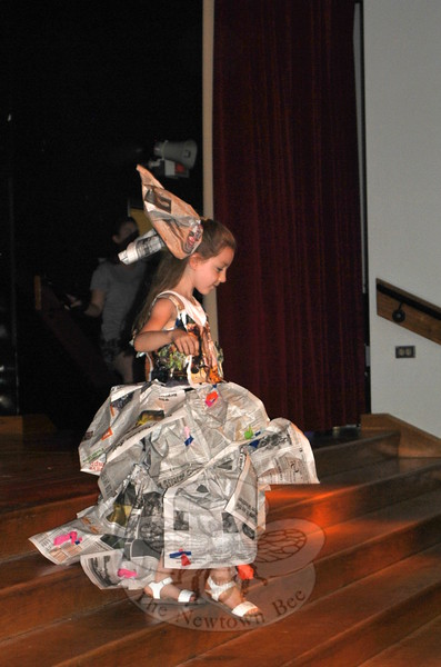 One of several participants in the SMART Fashion Design class models her fancy newspaper gown. Campers designed and made the outfits for a fashion show that capped off two weeks of SMART Camp. (Crevier photo)