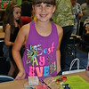 Eren Weiss, 8, is pleased with her collection of fused glass creations created over the two weeks of SMART Camp. (Crevier photo)