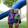 Friends Julia Dimyan, left, and Sara Ruddy stopped playing to take a moment's rest in the shade near a slide. (Bobowick photo)
