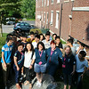 "Front row from left, Chinese leaders ""Betty"" and ""Beryl,"" Education First instructors Lynn Hungaski and Gretchen Ewers, and program director Jill Tino stand with students outside of Edmond Town Hall, where the 25 Chinese visitors practice English language skills each morning of their visit to the United States. (Crevier photo)"
