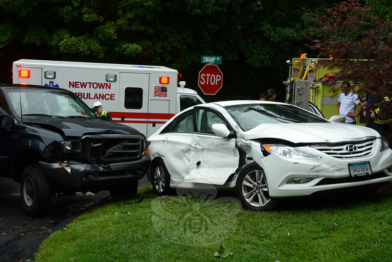 A three-vehicle accident occurred during wet conditions at the intersection of Swamp Road and Botsford Hill Road at about 12:40 pm on August 13. Police said the collision involved motorist Charles Hallas, 62, of Bridgeport, who was driving a 2013 Hyundai Sonata sedan; motorist Frank Dlugas, 42, of Shelton, who was driving a 1999 Ford pickup truck, and motorist Celeste Vodola, 50, of 9 Meadow Woods Lane, who was driving a 2004 Chevrolet Express van. Hallas received an infraction for making a restricted turn, police said. Dlugas was transported by ambulance to Bridgeport Hospital for unknown injuries, police said. Botsford volunteer firefighters responded to the accident. (Gorosko photo)