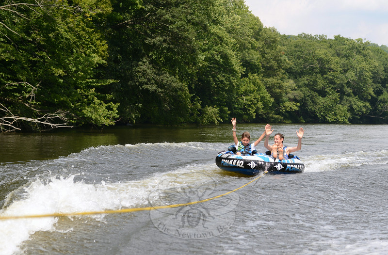 Clinic volunteer Joey Corrod shared a tube ride with participant Dave Dally during Freedom Splash, a new offering presented by Leaps of Faith Adaptive Skiers on July 31. The two laughed as their tube bounced across the boat's wake. (Bobowick photo)