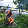 Sound Center Founder and Director Jennifer Zulli starts a fire in preparation for a sunset closure to her wellness fair event. (Bobowick photo)