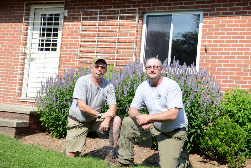 Newtown Forest Association President Bob Eckenrode, left, and the new NFA caretaker Dave Brooker met this week at the Holcombe Hill Wildlife Preserve on Great Hill Road. Mr Brooker now lives onsite where former resident Josephine Holcombe once lived. (Bobowick photo)